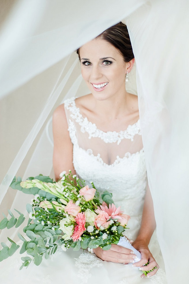 Bridal portrait under veil / Coral and Green South African Wedding // D'amor Photography