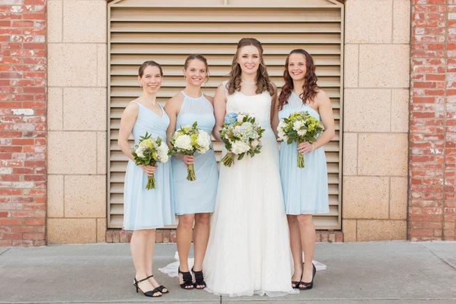 Pale blue short bridesmaids dresses. Modern Urban Wedding at Old Cigar Warehouse / Ryan and Alyssa Photography