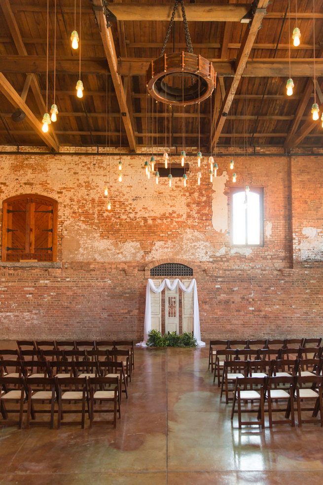 Modern warehouse ceremony location. Modern Urban Wedding at Old Cigar Warehouse / Ryan and Alyssa Photography