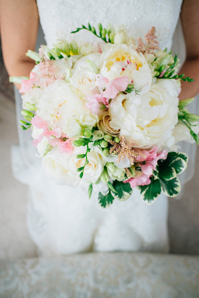Breathtaking Wedding Bouquet Recipe: White peony, white roses and pink spring blossoms. Click to blog for more gorgeous bouquet ideas.