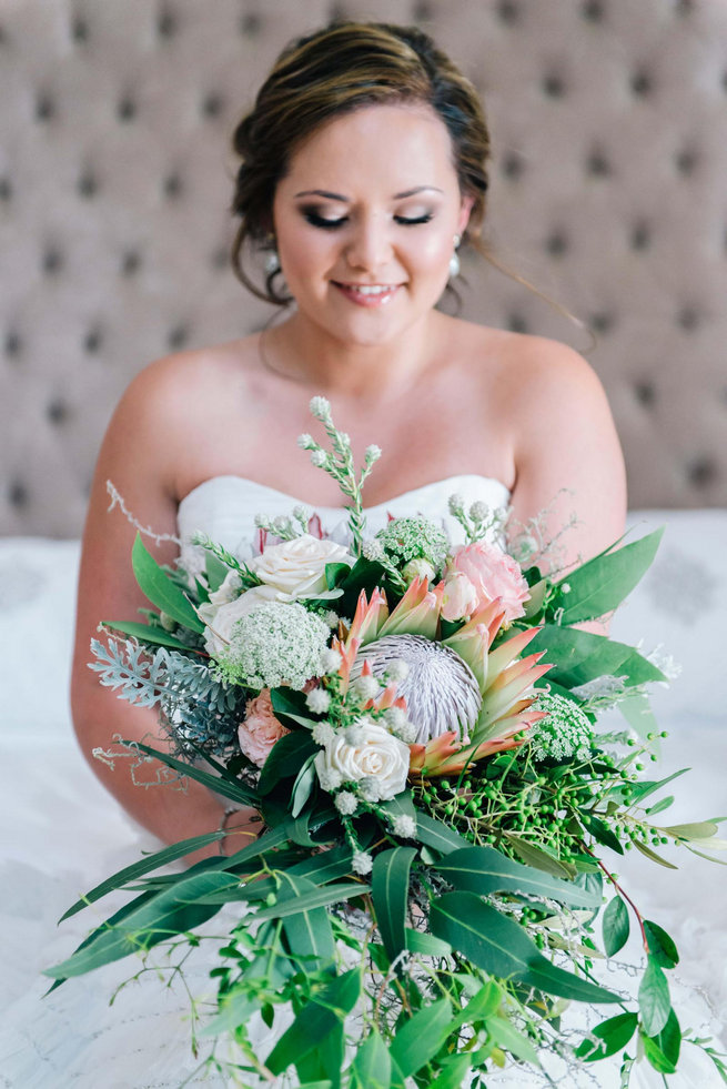 Breathtaking Wedding Bouquet: Cascading King Protea, Jasmine, Eucalyptus, rose and queen anne's lace bouquet. Click to blog for more gorgeous bouquet ideas.