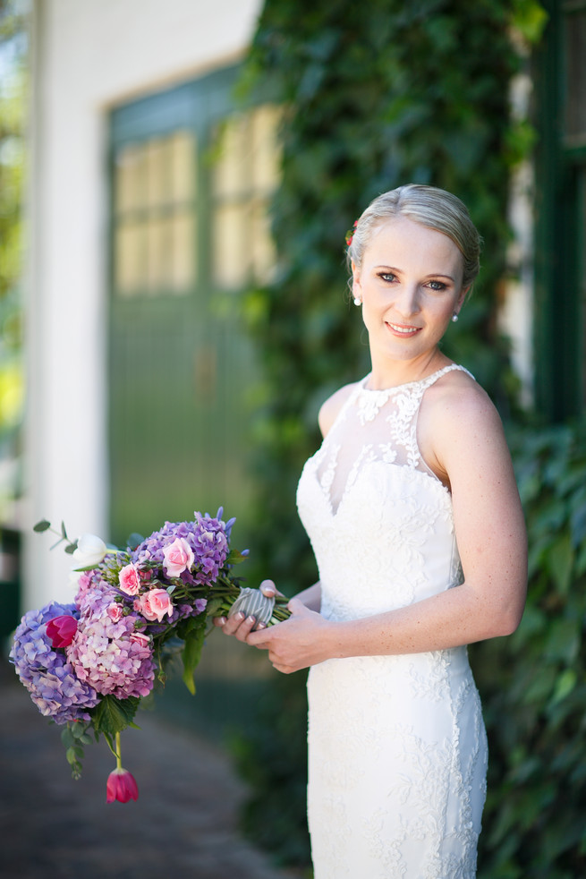 Breathtaking Wedding Bouquet: White tulips, pink tulips, pink roses, purple hydrangea and greens. Click to blog for more gorgeous bouquet ideas.