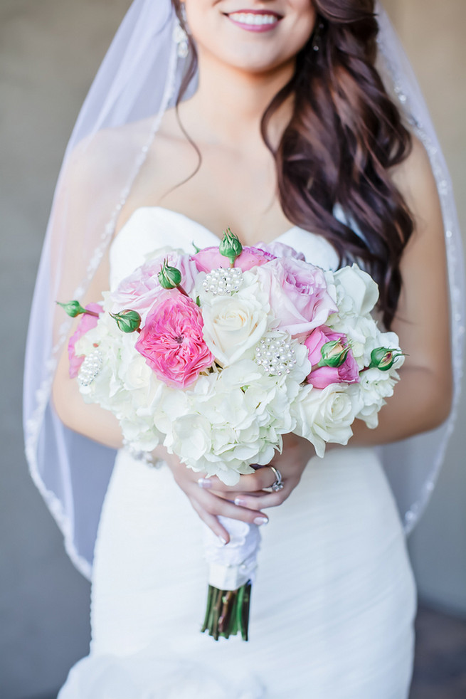 Breathtaking Wedding Bouquet: White hydrangea, pink and blush garden roses. Click to blog for more gorgeous bouquet ideas.