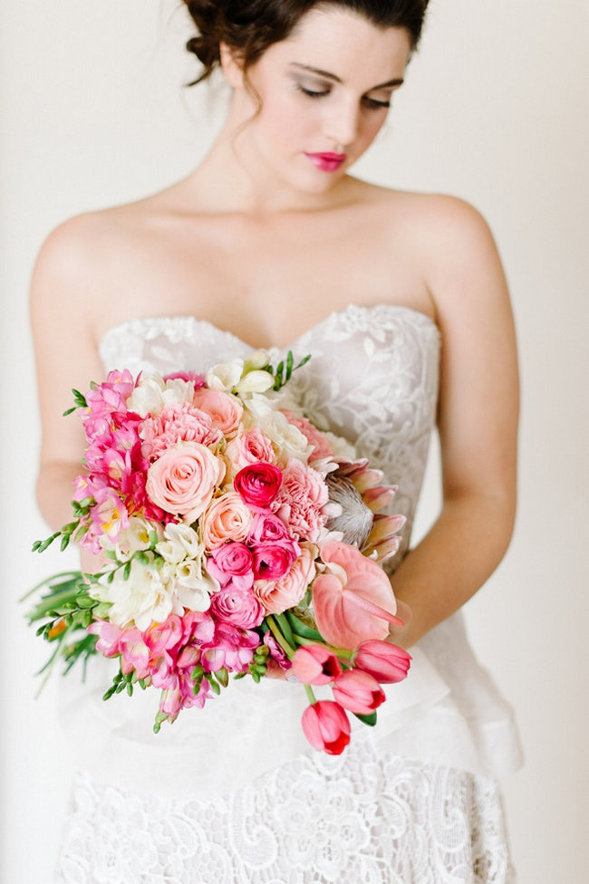 Breathtaking Wedding Bouquet Recipe: Pink Tulips, blush and pink roses, blush Lilly and Protea. Click to blog for more gorgeous bouquet ideas.