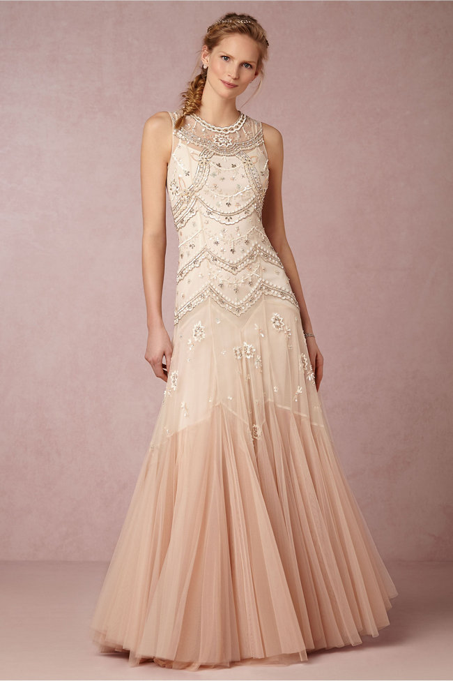 Chic, Sophisticated Wedding Dresses for Romantics: From the tiered layers of rose-hued ombre tulle to the tonal sequins and silver-cut beads, this stunning, contemporary gown has a head-turning silhouette that's perfect for the bride looking for something a bit unconventional.