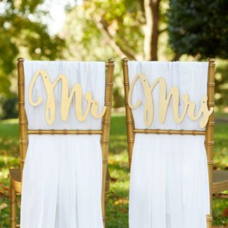 Lazer cut script style calligraphy Mr Mrs Wedding Chair Signs. See 20 more cute and creative ideas here: https://www.confettidaydreams.com/mr-and-mrs-signs/