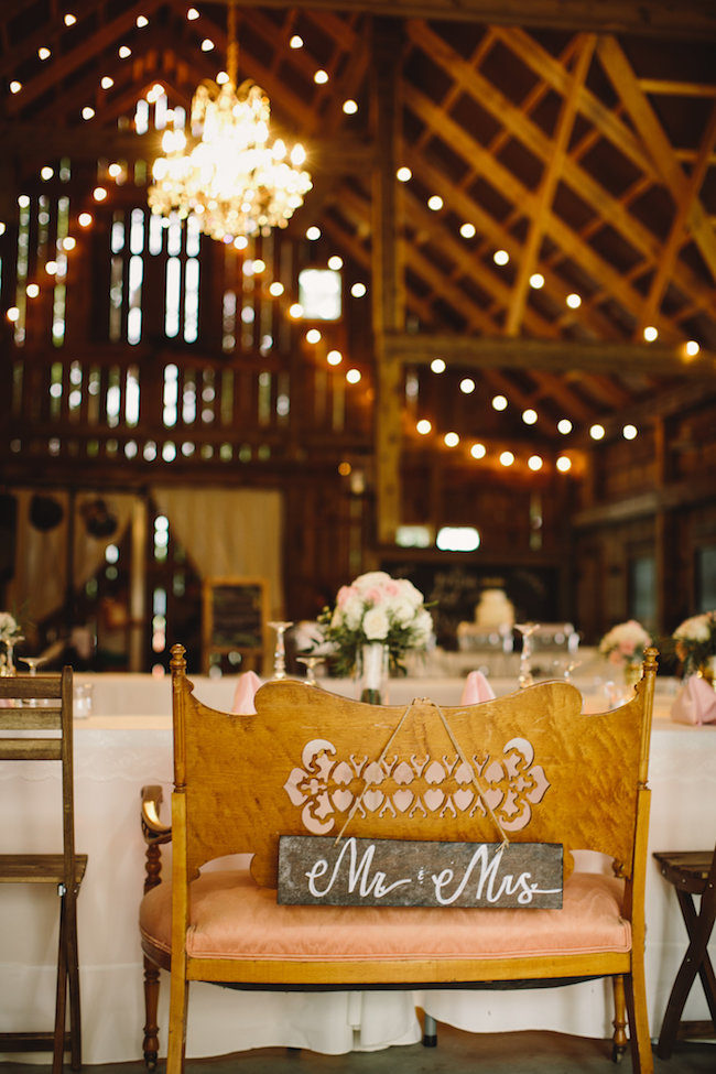 Mr and Mrs Loveseat Sign for a wedding sweetheart table Too cute! See more: https://www.confettidaydreams.com/mr-and-mrs-signs/  - Photo Jennifer van Elk Photography