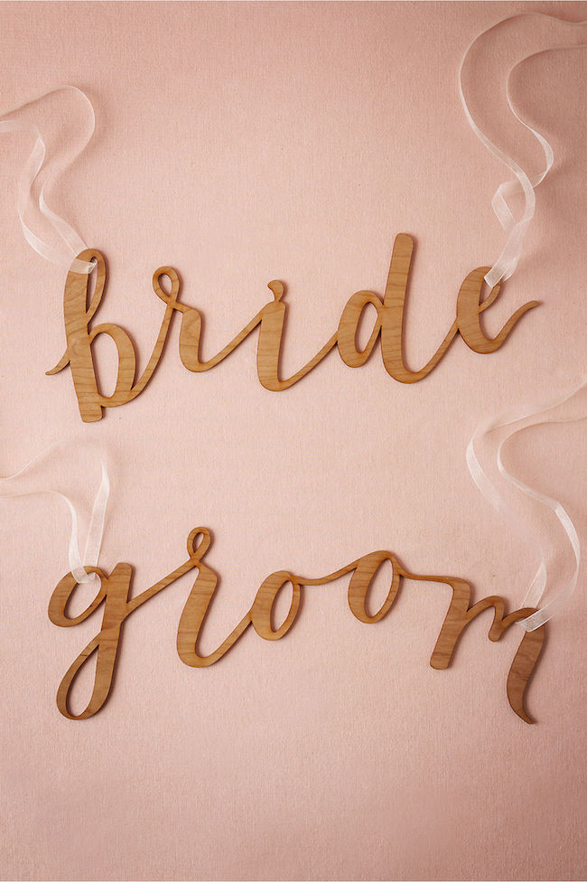 Mr and Mrs Signs chair signs for Bride and Groom in calligraphy. See 20 more cute and creative ideas here: https://www.confettidaydreams.com/mr-and-mrs-signs/