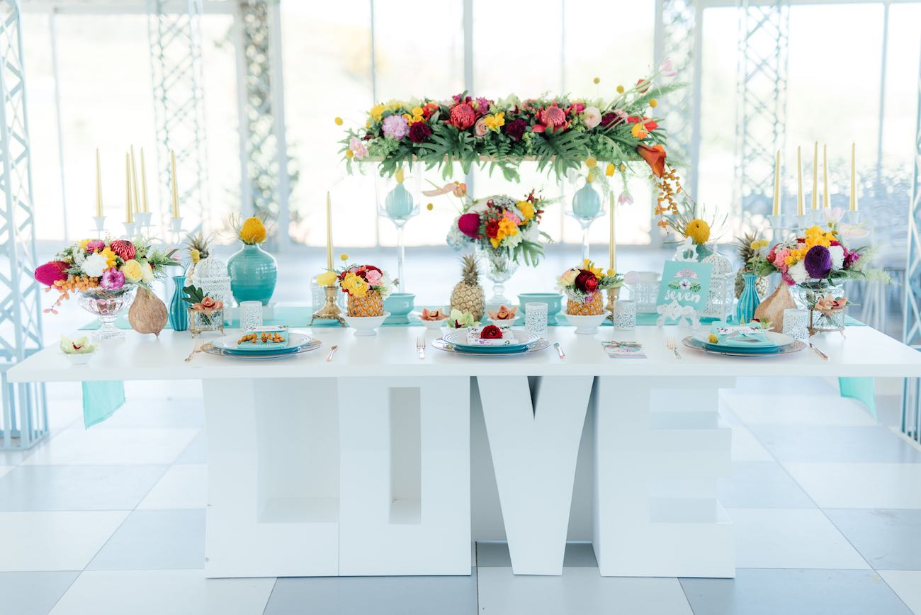 The LOVE sign makes the tropical sweetheart table even more perfect. Click for the most absolutely gorgeous Tropical Wedding ideas ever!
