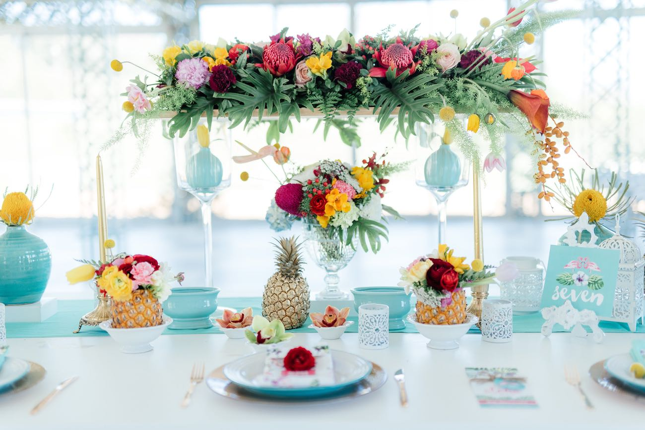 Bright greens, warm reds, orange and pretty pinks with a touch of mint make this tropical wedding decor a dream. Click for the most absolutely gorgeous Tropical Wedding ideas ever!
