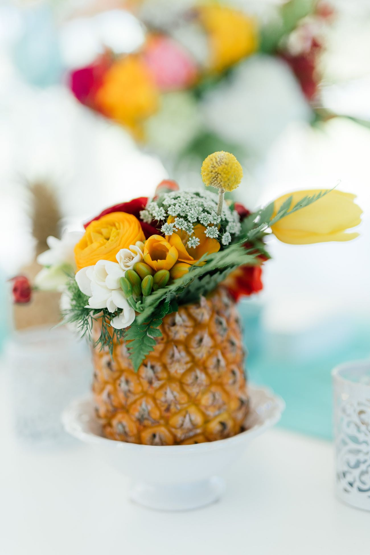 Pineapple filled with tropical flowers. Click for the most absolutely gorgeous Tropical Wedding ideas ever!