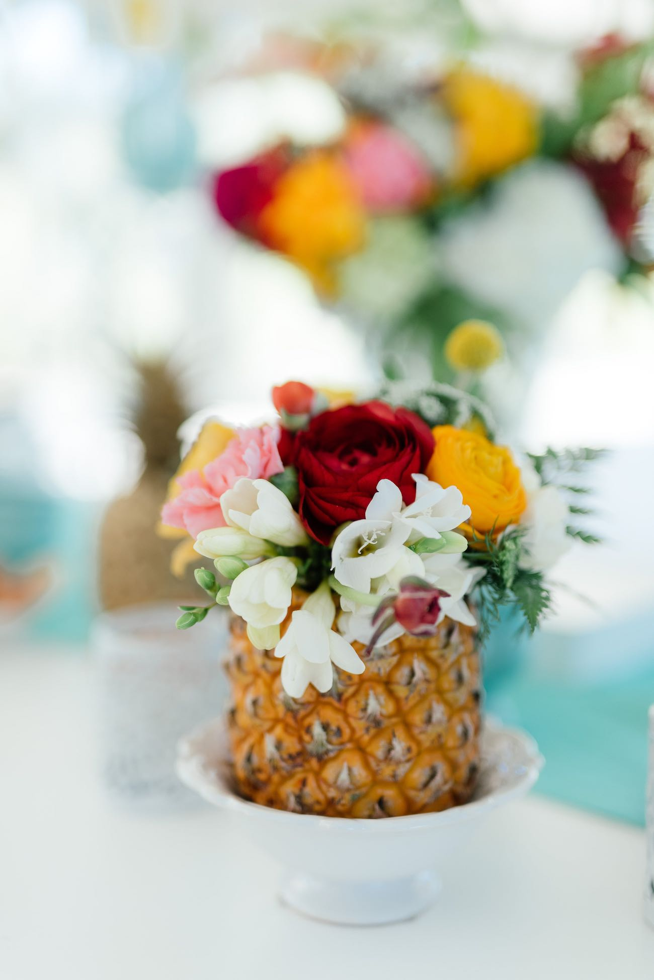 Pineapple wedding flower centerpieces! Click for the most absolutely gorgeous Tropical Wedding ideas ever!